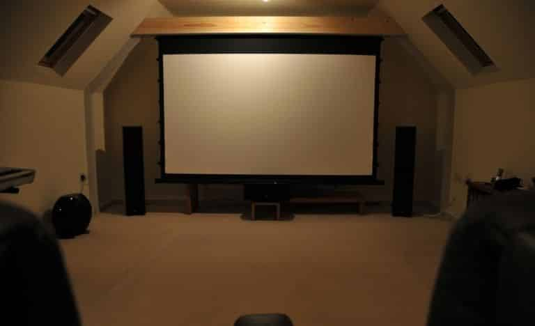 How do you suspend the projector screen in the vaulted or sloped ceiling?
